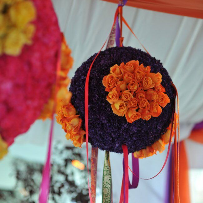 The outdoor tented areas were given a festive look with multicolored spheres created from flowers and hung with decorative ribbons.
