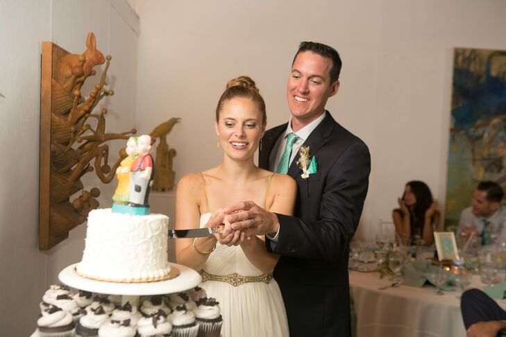 "The couple cut into the top ""layer,"" a small couple's cake, that sat atop a tower of cupcakes made by the bakers at Cake That! in Manahawkin, New Jersey."