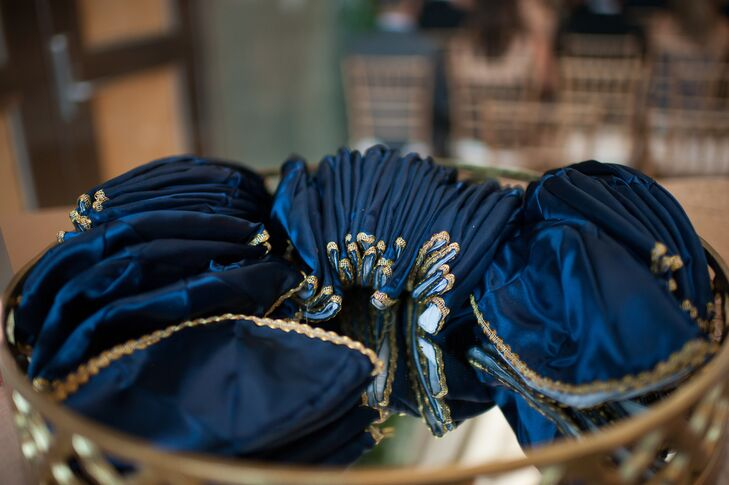 Each guest received a program filled with information about Jewish wedding traditions, plus champagne flutes and personalized yarmulkes (the traditional Jewish head covering).