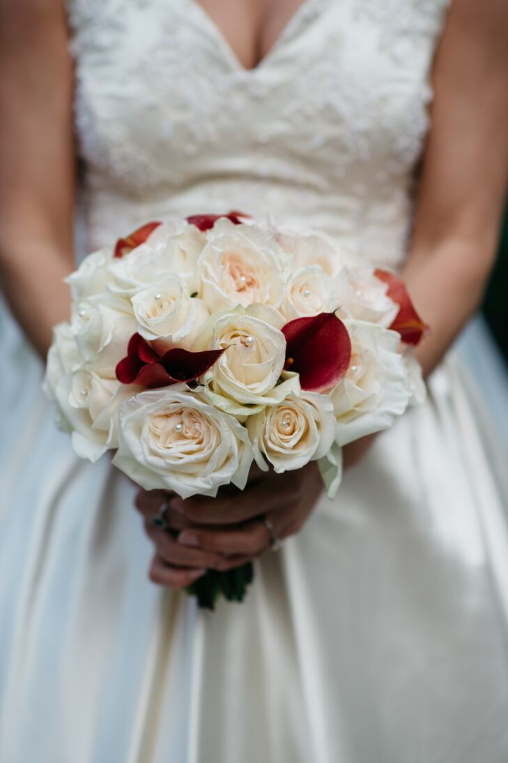 Kara carried red calla lilies and white roses in her lush bouquet. She accented the center of the roses with pearls for a touch of glamour. She wanted her bouquet to be simple and sweet, but she also wanted it to match her wedding colors. The florist at Fearrington Village in Pittsboro, North Carolina, found the perfect balance.