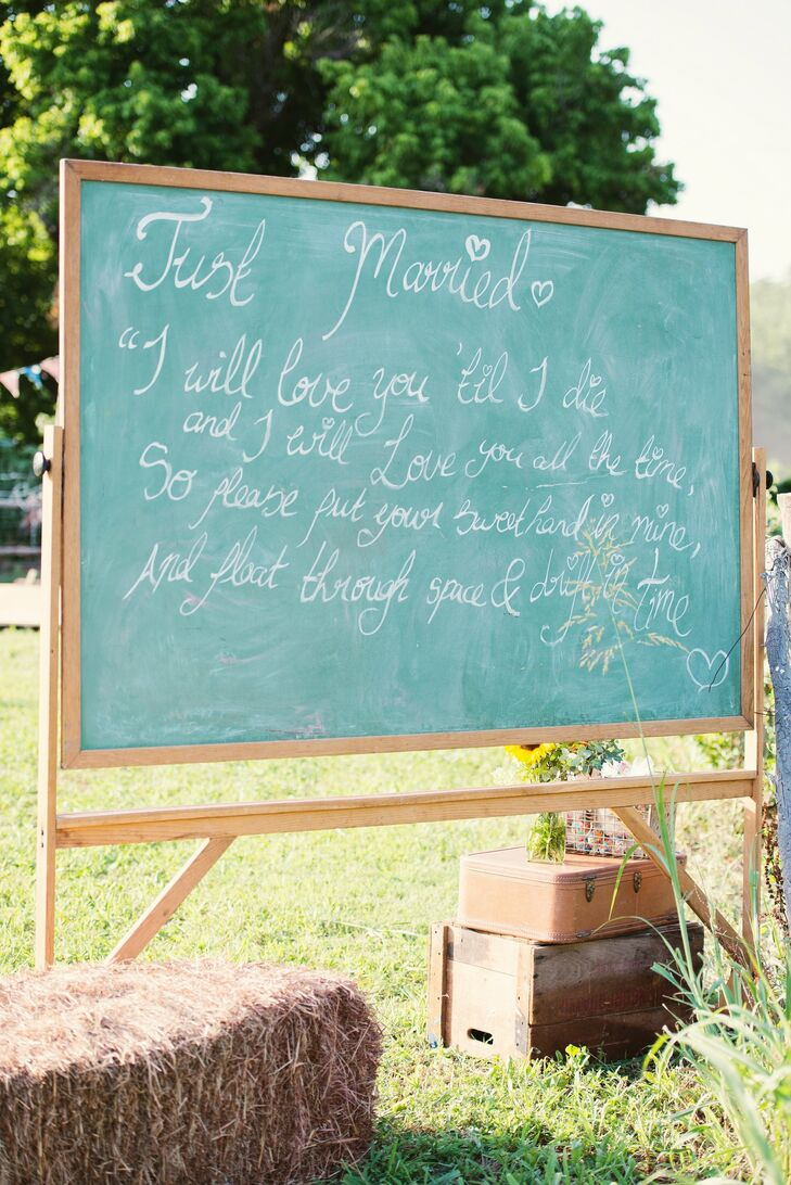 Part of the DIY decor at the reception was a chalkboard that had a romantic quote written on it to celebrate the just married couple.