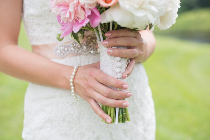 Jennifer's aunt made this bouquet wrap using the bride's grandmother's wedding gown, using its delicate buttons to line the stems.