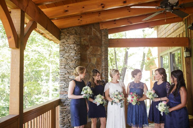 The bridesmaids chose their own navy dress.