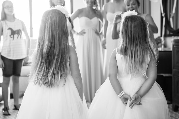 Zach's niece and the Maid of Honor's daughter served as the couple's flower girls. Each wore white tulle dresses from David's Bridal and carried flower wands crafted by Tommy Murphy from Greenery Productions, says Stephanie.