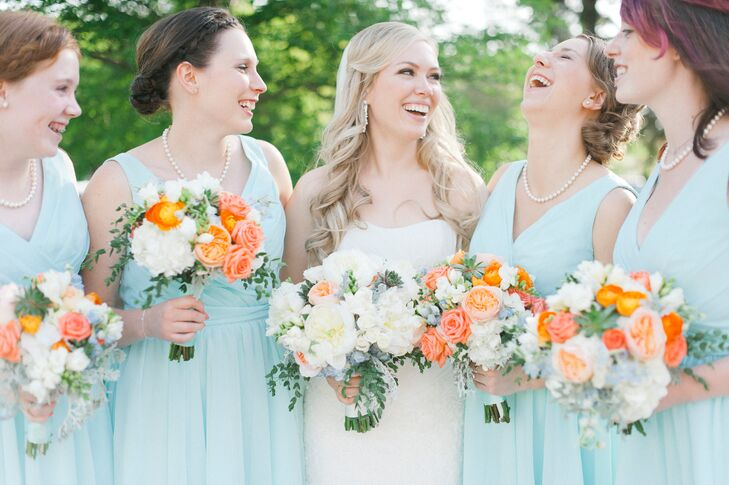 Katie decided to take the traditional route and had her bridesmaids don matching dresses. She chose an icy blue Kennedy Blue design in a short, A-line silhouette that was flattering on all of the girls and could easily be worn again. The addition of pearl necklaces and bracelets, both gifts from Katie, added to the classic, timeless feel of their look.