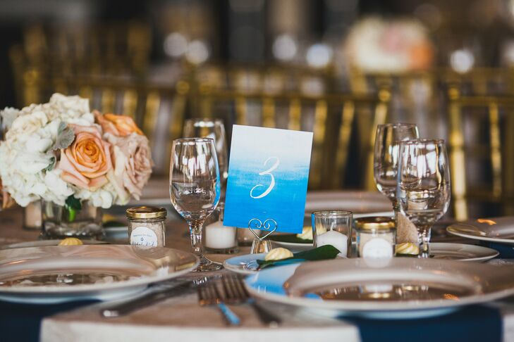 Every table number brought out their wedding color with a chic design. Blue ombre hues served as the background for each white number. The combination also matched their ombre blue wedding cake from Carlo's Bakery.