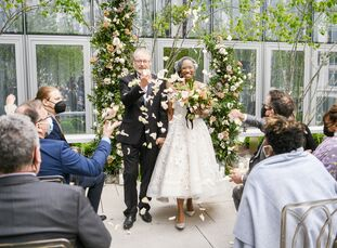 Melva and Emmanuel tied the knot in an April wedding at the Conrad Hotel in Washington, D.C., with a color palette of purple, black and green. However