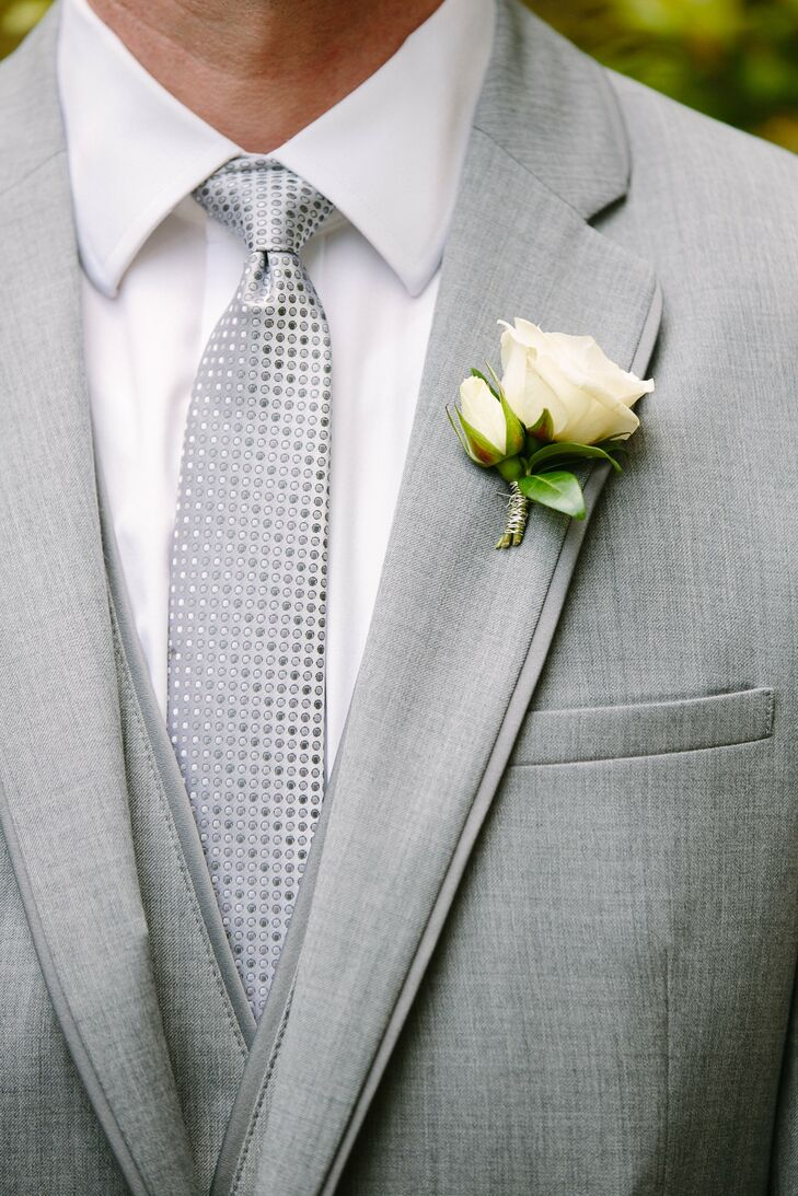 Jim wore a three-piece gray suit with a metallic gray tie and a simple rose boutonniere.