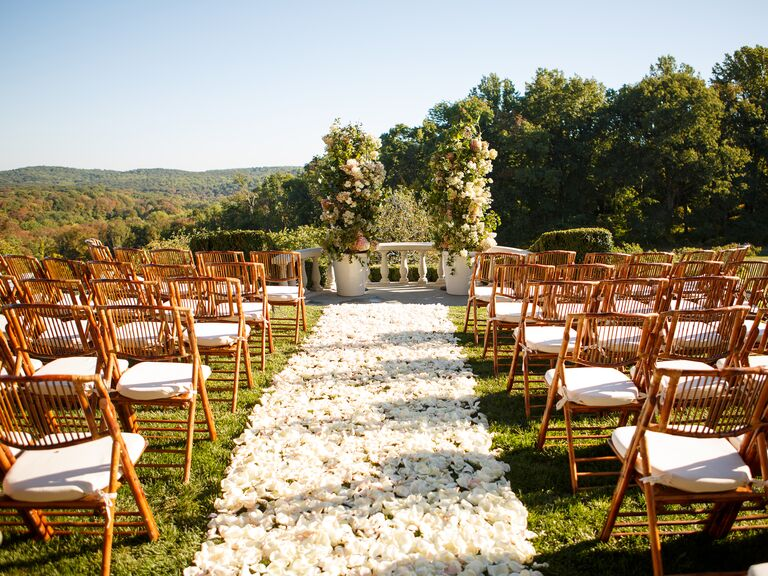 Rose petal decorated wedding aisle