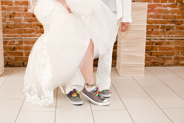 The brides got married in gray Converse sneakers, complete with rainbow shoe laces. Their shoes reflected their laid-back, casual nature, which showed in their wedding atmosphere.