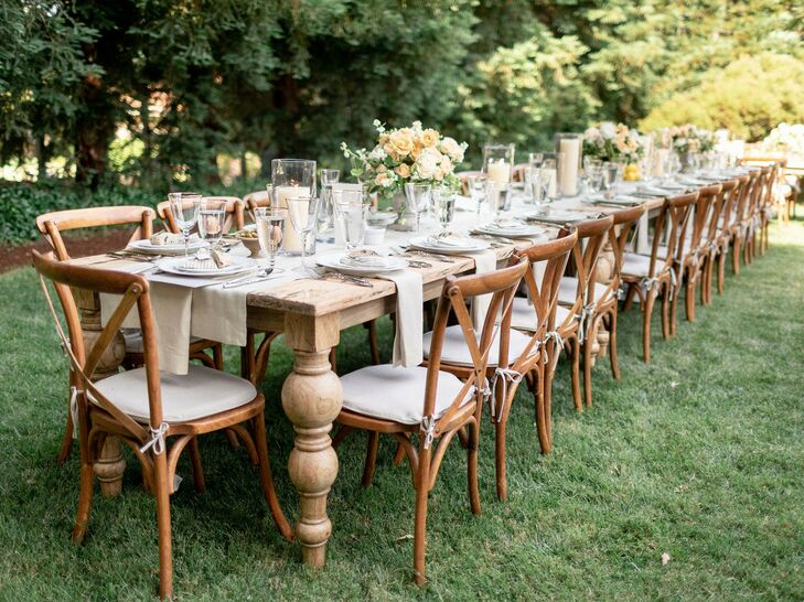 Wood Dining Table with Cross-Back Chairs in Backyard Reception