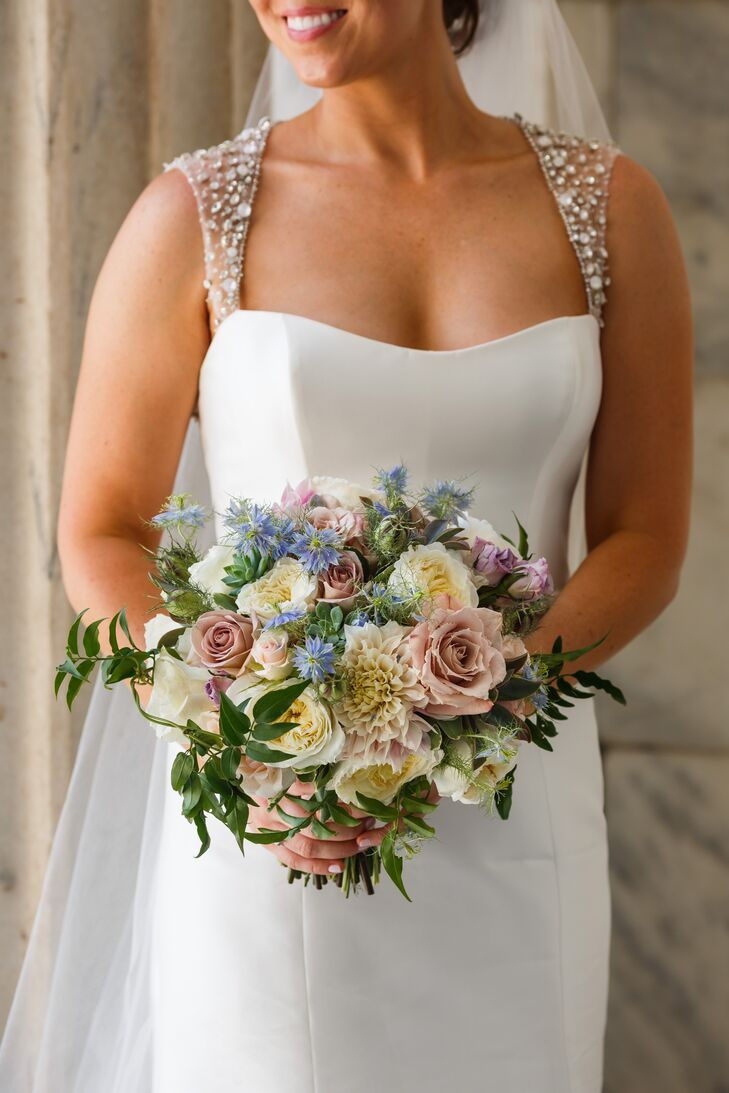 Using a soft color palette filled with champagne and blush, the bridal bouquet embodied a natural, vintage look to fit the garden-inspired theme. Blooms ranged from garden roses to dahlias, mixed with succulents and ivy.