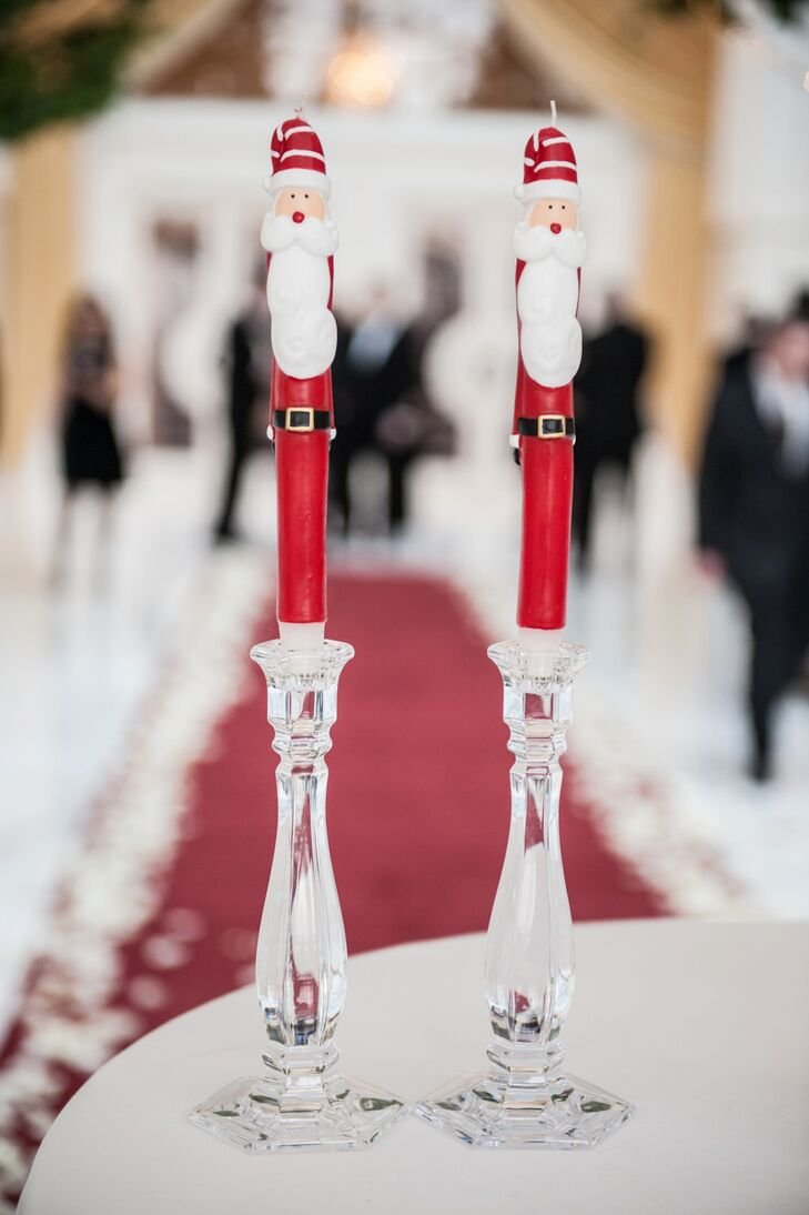 Francesca and James had a unity candle ceremony with their mothers during their nuptials, which included these adorable Santa candles and crystal candlesticks.