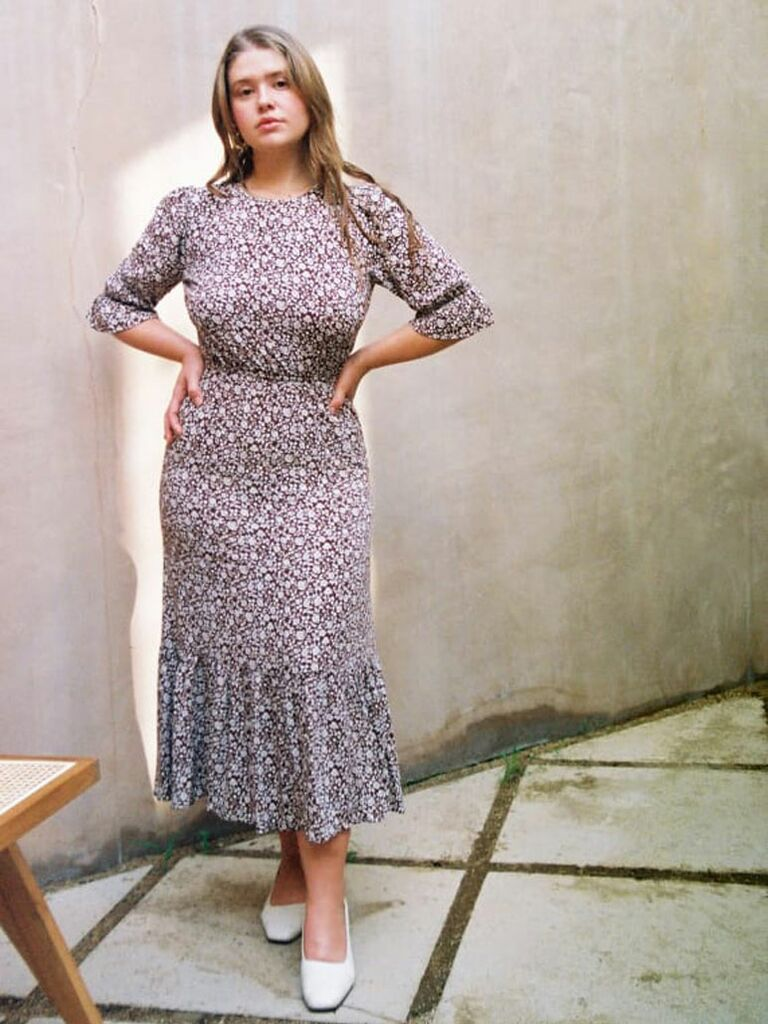Dark brown floral cottagecore dress with 3/4 length sleeves and ruffled midi skirt
