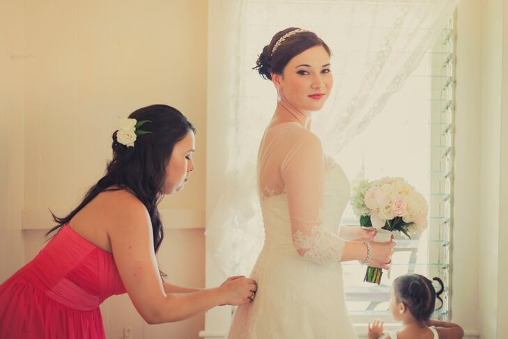 """""""I wanted an upcountry classic country wedding and a wedding gown that was timeless,"""" says Tara. """"My only bridesmaid and Maid of Honor was my sister, who wore a simple pink floor length gown."""""""