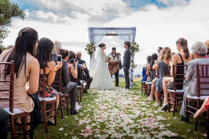 """""""We were married at Kahua Ranch on the rolling hills on the Big Island of Hawaii, an we had a rustic wedding overlooking the ocean,"""" says Tara. """"It was a small intimate wedding of 100 of our closest family and friends, and the weather was perfect."""""""