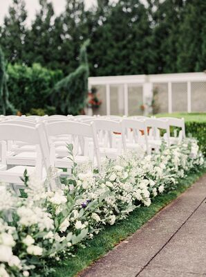 Elegant Aisle Decorations with White Flowers and Leaves