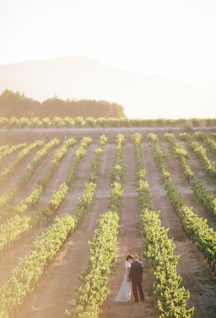 Jason and I basked in the sunset, stole a few kisses and vowed to remember that moment and that blissful feeling for the rest of our lives, Rachel says of their postceremony photos in the vineyard.