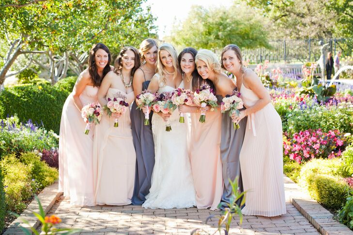 Kristen told her bridesmaids that as long as their dresses were either gray or blush, they could wear whatever style they wished, allowing each bridesmaid's unique sense of style to shine through.