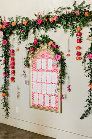 Bright Framed Seating Chart Display with Hanging Flowers