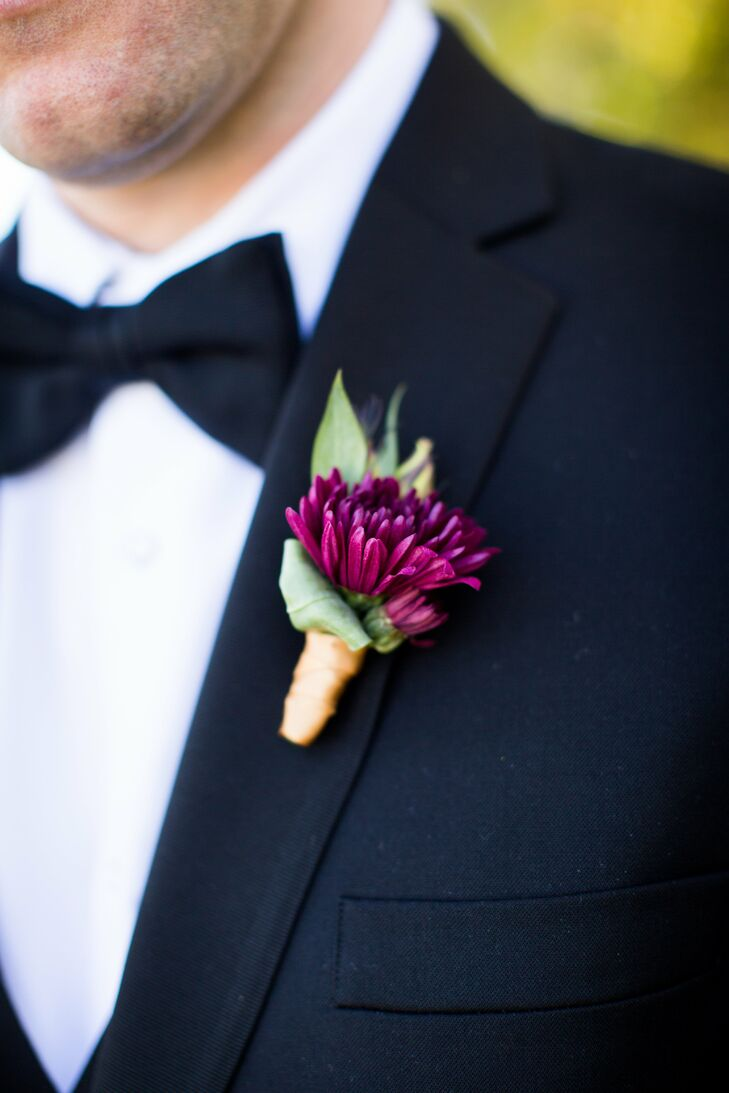 Eric and the groomsmen wore small, simple purple mum boutonnieres.