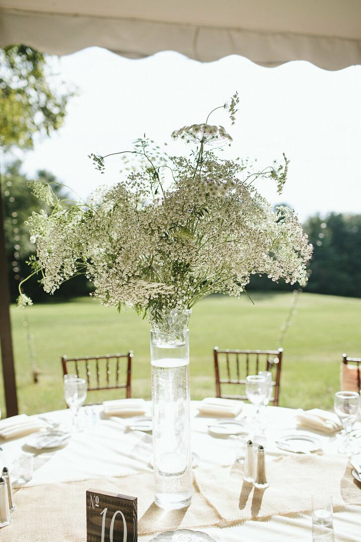 Tall centerpieces topped some of the guest tables, and were filled with lacy white blooms like baby's breath and bridal veil.