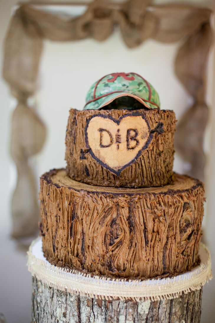 The rustic tree trunk groom's cake was carved with the couple's initials and topped with a baseball cap.