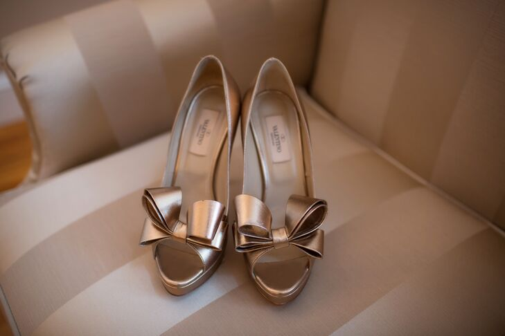Demetra accessorized her classic ball gown with gold  Valentino peep toe pumps with oversized bows.