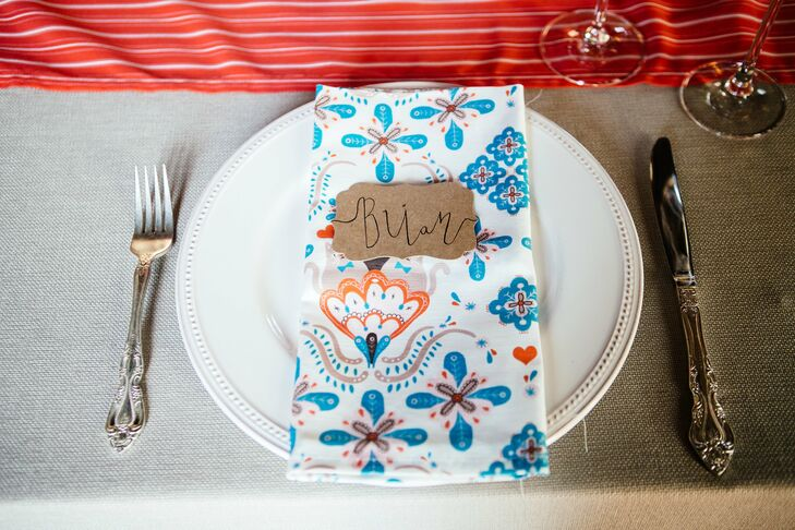 Each place was set with white china, playful patterned linens and hand calligraphed kraft paper place markers.