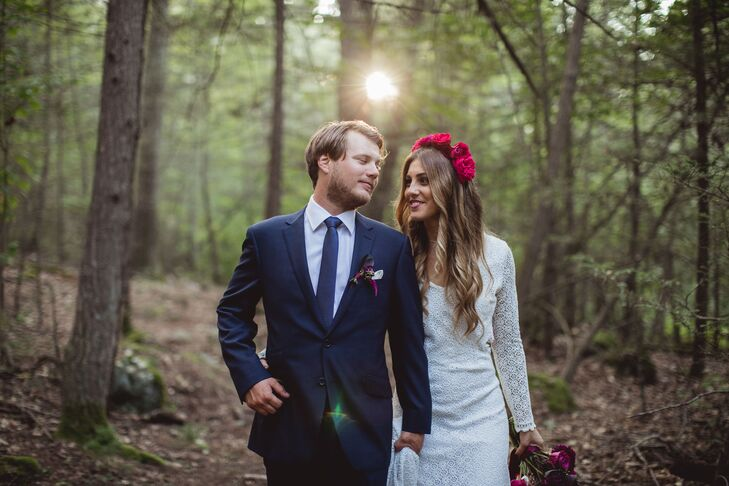 To match the laid-back vibe of their backyard bash, Jon ditched the traditional tuxedo for a sharp navy suit, crisp white button-down shirt and a matching navy tie. He completed the look with sleek brown dress shoes and a white pocket square. His groomsmen followed suit, opting instead for blue shirts that let Jon's getup stand out.