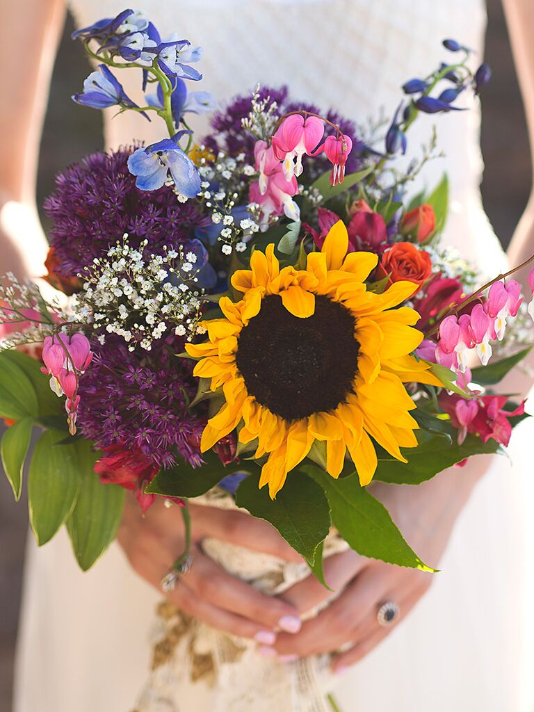 Charming sunflower wedding bouquets a colorful bridal bouquet with a large sunflower and roses junglespirit Images