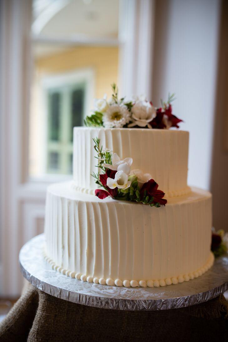 White Buttercream Wedding Cake With Fresh Flowers