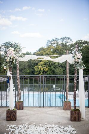 Simple Rustic Wedding Arch With White Drapery