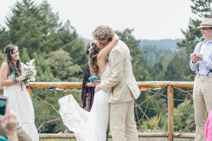"""Jayme and Jeremy shared their first kiss at their woodland ceremony, where they incorporated their love for music. Their two good friends sang before the ceremony began, and Jeremy sang """"La Vie en Rose"""" as Jayme walked down the aisle."""
