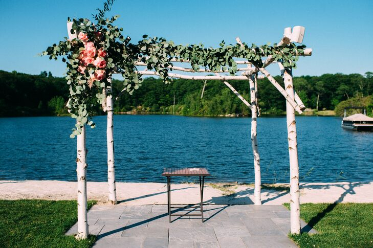 With the help of Ibranyi Is Floral, Kim and Nick used an abundance of greenery to mark their waterfront ceremony. Each post along the front of their birchwood wedding arbor overflowed with seeded, silver dollar eucalyptus and romantic pink garden roses. We love how they captured the Rock Island Lake Club's tree-filled grounds in Sparta, New Jersey, with an organic design.