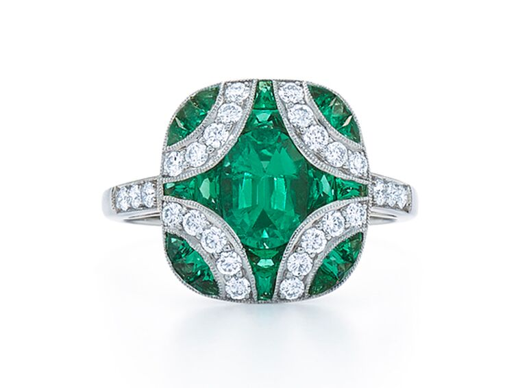 Emerald engagement ring with pavé diamonds