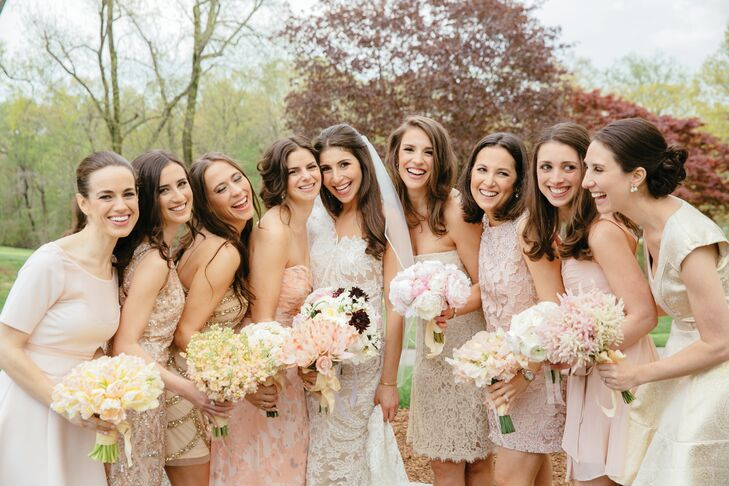 Each bridesmaid wore a distinct dress within Jenna and Mike's neutral, blush and ivory color palette. Intricate beading, paisley prints, lace appliqués and chiffon were all part of their looks. Their bouquets from Michael George drew on this and were all different with peach calla lilies, romantic hydrangeas, white ranunculus and much more.