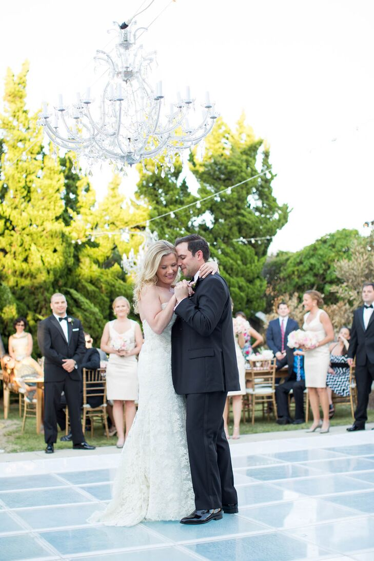 Ryan and Brian had a custom chandelier made to hang over the glass-covered pool turned dance floor. The couple loved the look of the glowing pool and the ambiance it created for the dance party. The crystal chandelier and string lights were the perfect touch.