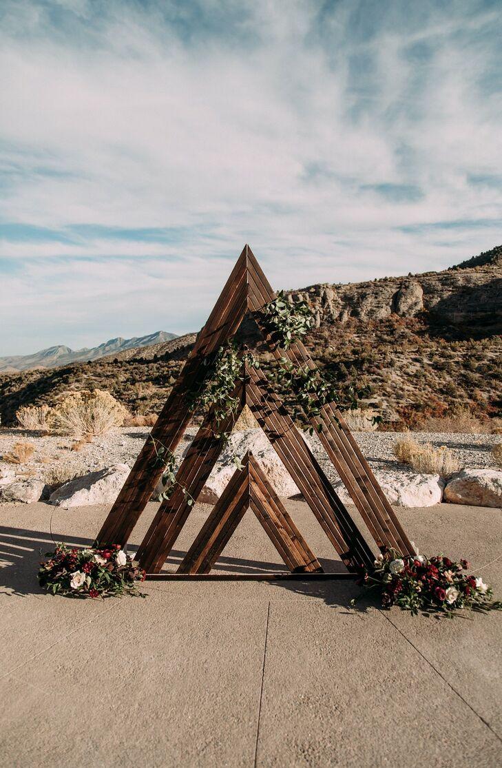 Triangular Wood Wedding Arch with Rustic Flower Arrangements