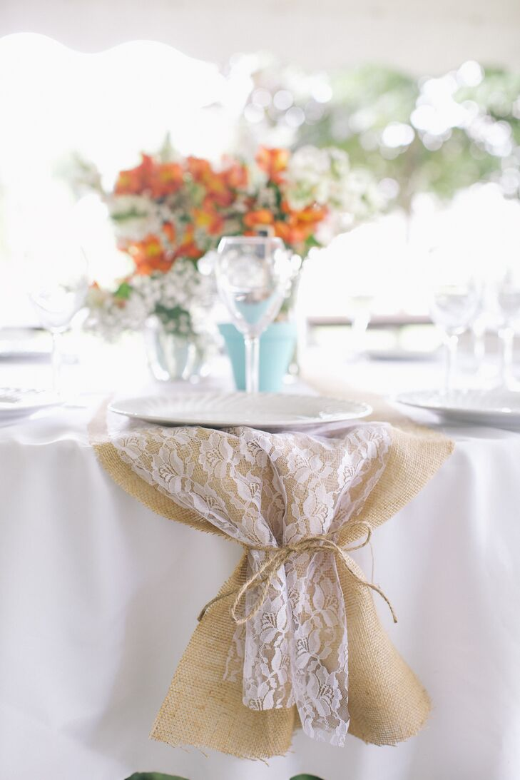 The beautiful burlap and lace table runners were created by the mother of the bride.