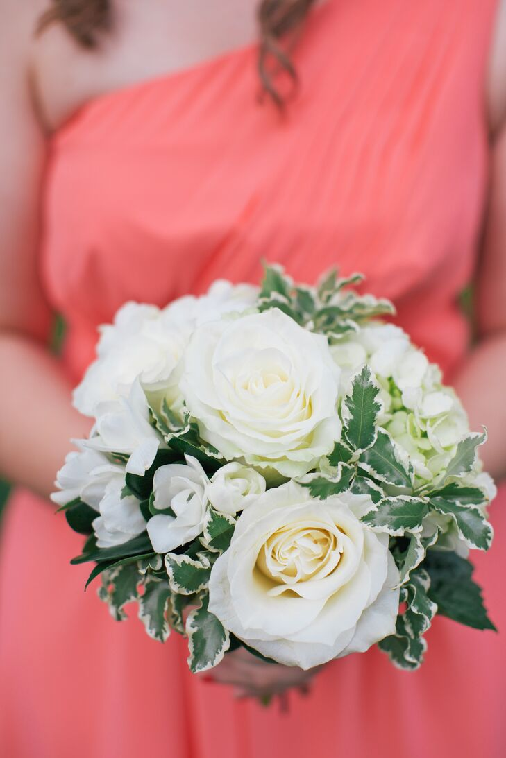 The bridesmaids carried small white bouquets of roses and freesias.