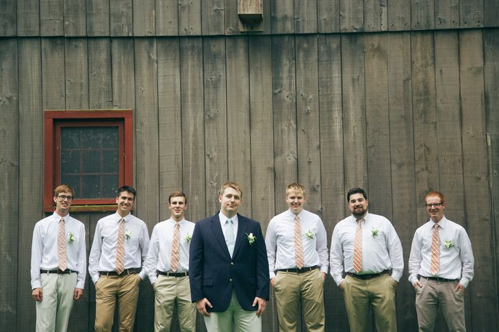 The groomsmen wore suits with khaki slacks and coral ties. Carey wore a navy blue blazer. All of the men in the wedding party wore white freesia boutonnieres.