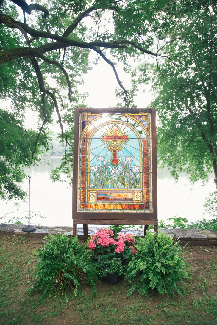 The altar at the outdoor ceremony in the park was decorated with stained glass from Carey's church.