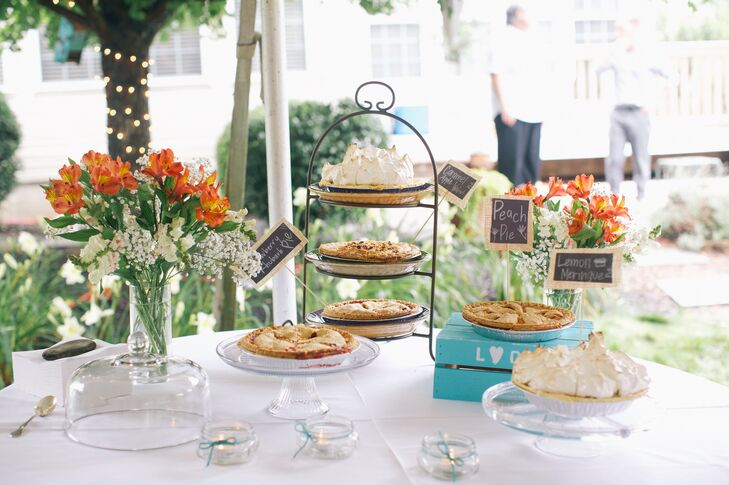 Instead of a traditional wedding cake, Lindsay and Carey served a variety of pies from local bakeries. The signs that labeled the pies were made out of chalkboard and burlap.
