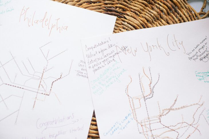 Guests at Carey and Lindsay's wedding signed subway maps of cities that are significant to the couple.