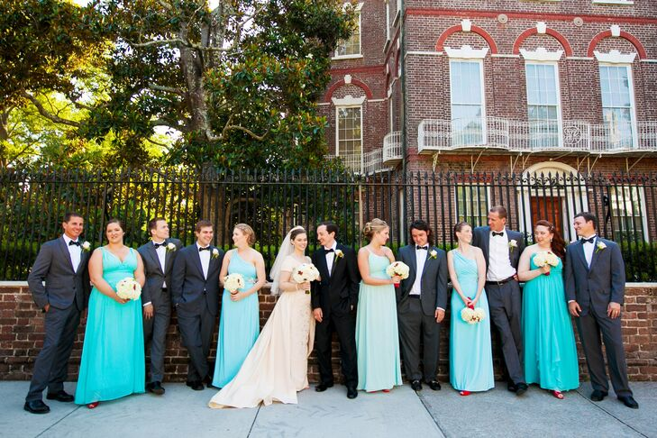 The bridesmaids wore floor-length formal gowns in several bright shades of blue. The girls were able to pick the style they liked the best, choosing from strapless, one-shoulder and v-neck styles.