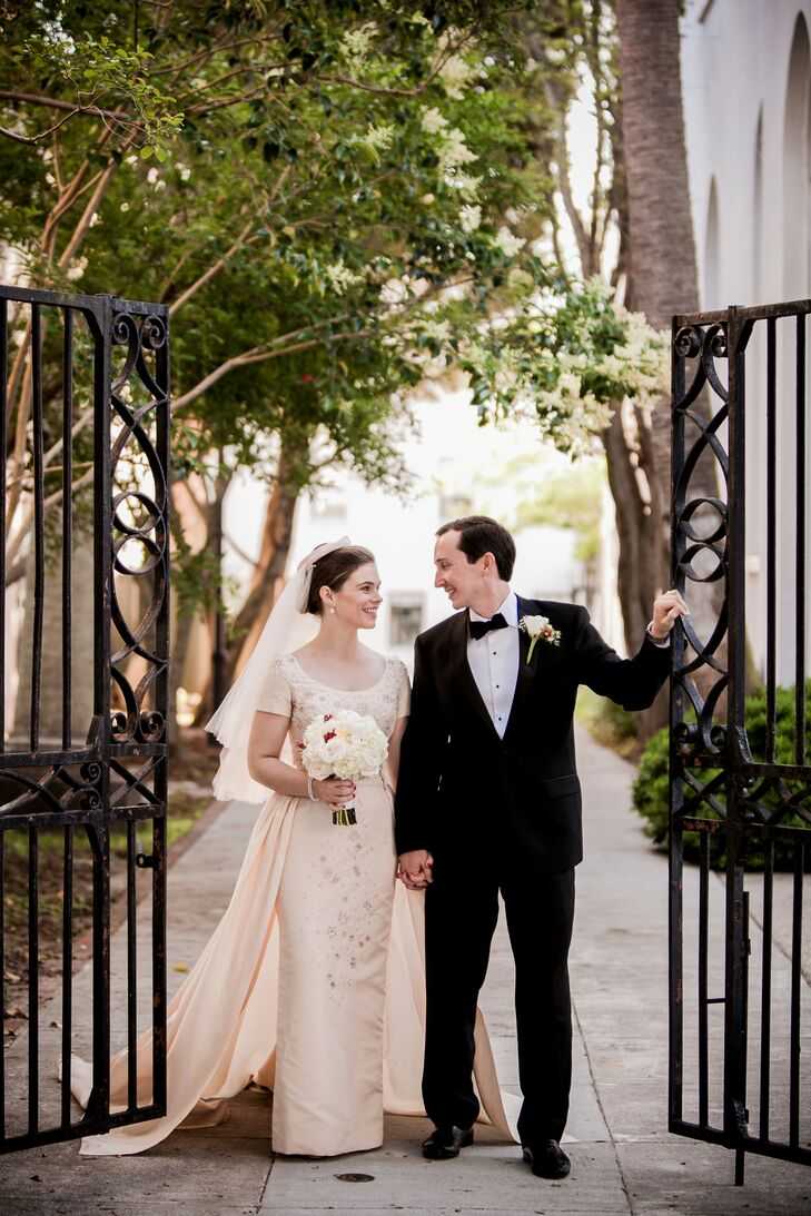 For Helen, wearing her grandmother's 1954 Cahill of Beverley Hills wedding dress was an absolute must. The elegant column gown featured a scoop neckline, short sleeves and was dotted with dainty floral embellishments.rn