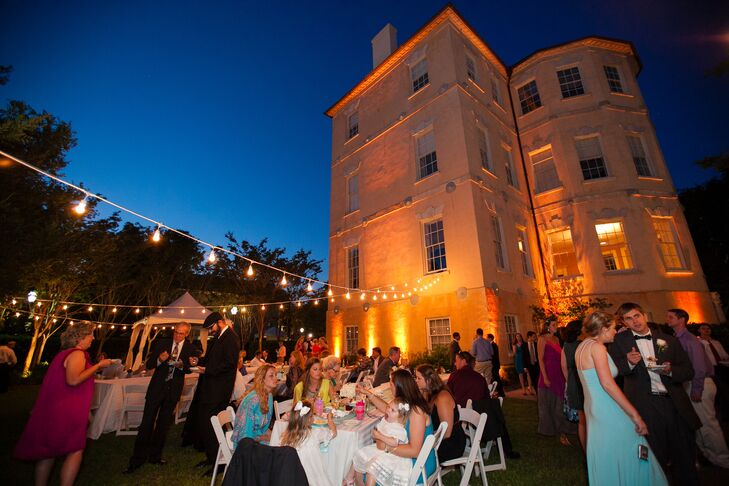 A stately, historic venue was just what Helen and Glenn's traditional wedding called for and they found it in the Spoleto Festival USA building (also known as the Murray Center). The newlyweds and their guests spent a lively evening of dinner dancing out on the Center's lawns with the band Mike & the Mixers busting out the 80s beats.rn