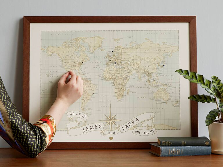 Personalized push-pin world map in brown wood frame