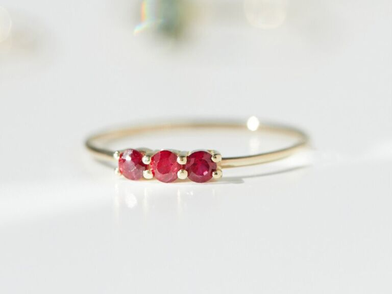 Three-stone ruby ring with thin yellow gold band